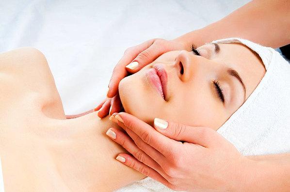 woman doing face treatment