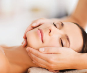 woman enjoying facial massage